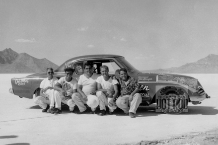 Bonneville August 25-31, 1958. The Kamboor-Sanchez-Ansen Special #201 Class D Coupe and Sedan. A 1953 Studebaker set a new two-way average of 184.479 mph powered by a Chrysler Hemi early in the week. With 100% Nitromthane the car qualified for a new record at 210.40 mph. The first leg the car ran 210. On the return run the engine blew up. This is the first Coupe and Sedan class car to exceed 200 mph,4th from left, Louis Senter Louis Senter Collection